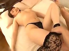 Striking Japanese milf strips off her clothes and enjoys a