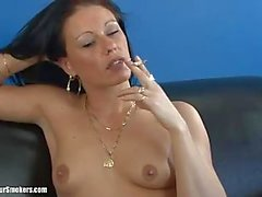 Sultry brunette milf with small tits enjoying a good smoke