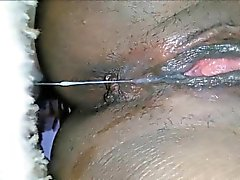 Black MILF masturbates and squirts