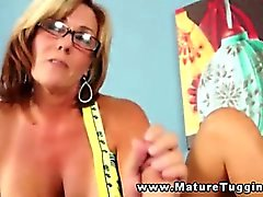 Busty brunette spex giving handjob to lucky guy