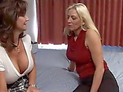 Two beautiful milfs with nice tits eat pussy