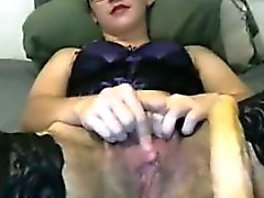 Hairy all natural milf rubs her tight hairy pussy