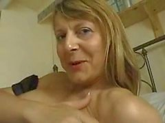 Mature maid uses dildo