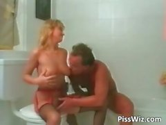 Blonde chick fucks in the bathroom