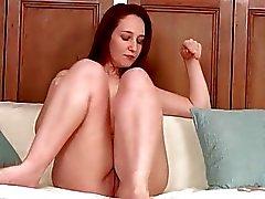 Very seductive redhead housewife masturbates on the sofa