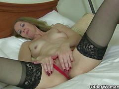 Redheaded milf Amber Dawn looks so slutty in black lingerie