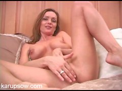 Get in bed with a naked mom as she masturbates