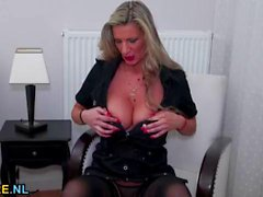 Busty European mature pleasures herself