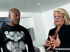 Kinky blonde milf eyefucks a huge black guy