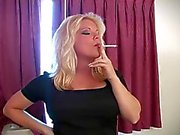 Hot Cougar Smoking in Heels, Nylons and Leather Skirt