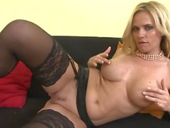 Hot milf babe in black stockings rubs her cunt