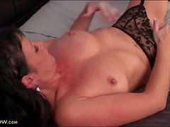 Milf flicks her clit in sexy stockings