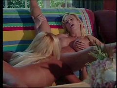 Two busty blondes have hot lesbian sex on couch