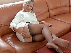 MILF shows her stockinged feet