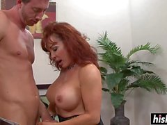Busty milf takes care of a dick