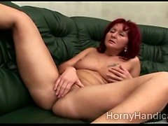 Sexy redhead caregiver masturbates alone on the couch