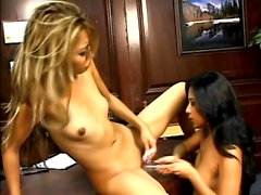 Sexy slender Oriental cuties fuck each other with a double-ended dildo