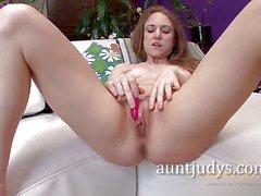 Sumptuous brunette toys her moist slot