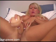 Dildo drives into her milf pussy in close up