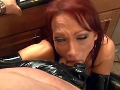 Brunette fucked in the kitchen wearing latex gloves a corset and stockings