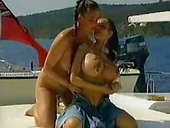 Pierced milf pussy is fisted on the boat