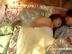 Bosomy Asian cougar gets creampied by her teen lover