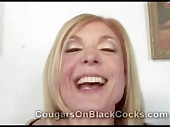 Blond cougar in stockings Nina Hartley rides meaty black tool