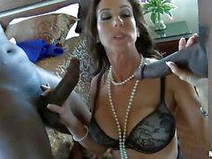 Brunette MILF in lingerie takes two black dicks