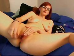 Busty redhead Canna poses her hot body and then toys her pussy