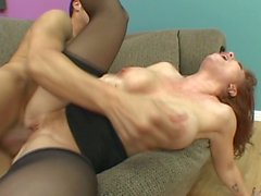Redhead milf whore in black stockings gets fucked