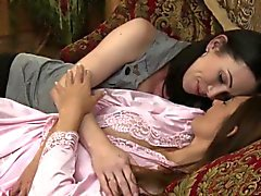 Lesbian lovers sensually kissing in bed