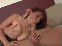 Hot milf in tight corset gives a great titjob