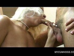 Blonde on knees sucks dick and swallows cum