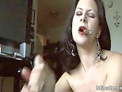 Sexy brunette hoe smokes a cigar part6
