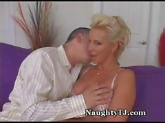Busty blonde MILF isn't lonely for long when young dude comes along for a fuck