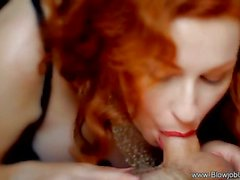 Redhead stuffs her mouth with cock