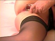 Brunette toys her asshole while fingering her pussy