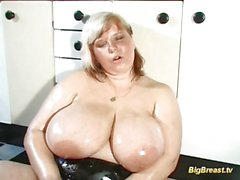 Blonde MILF with extreme big natural tits
