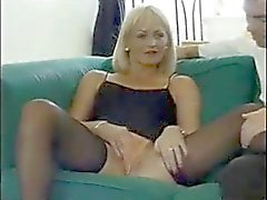 Watch the blonde milf play with dicks