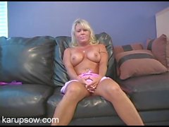 Topless milf in a miniskirt gives a fun interview