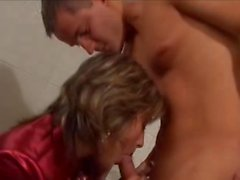 Woman In Red Satin Blouse & Boots Gets Fucked