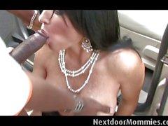 Cougar takes a black cock outdoor