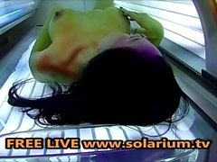 Horny Milf fingering and masturbating in the public solarium spy Hidden Cam
