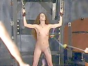 Slave gets bound to a wheel with restraint cuffs gets pussy play with mistress