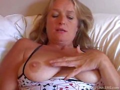 Hot milf teases pussy with vibrator after a shower