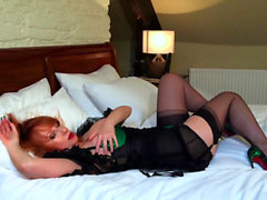 Naughty mature redhead fucks her pussy with her heels