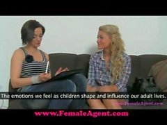 Curly-haired blonde and a brunette do some couch lesbian sex