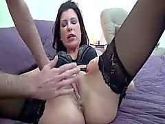 Brunette MILF got a great feeling fisting her cunt