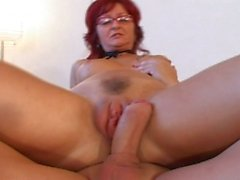 Redhead milf banged by young dong