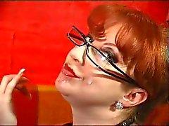 Redhead milf gives blowjob